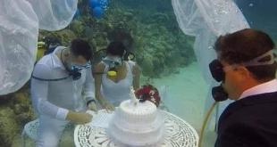 تقاليع الزفاف.. عقد زواج بفستان وبدلة فى أعماق البحر.. صور - اليوم السابع